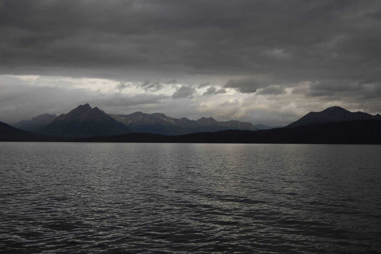 Mountains, clouds, and sunlight in the Strait of Magellan. Photo