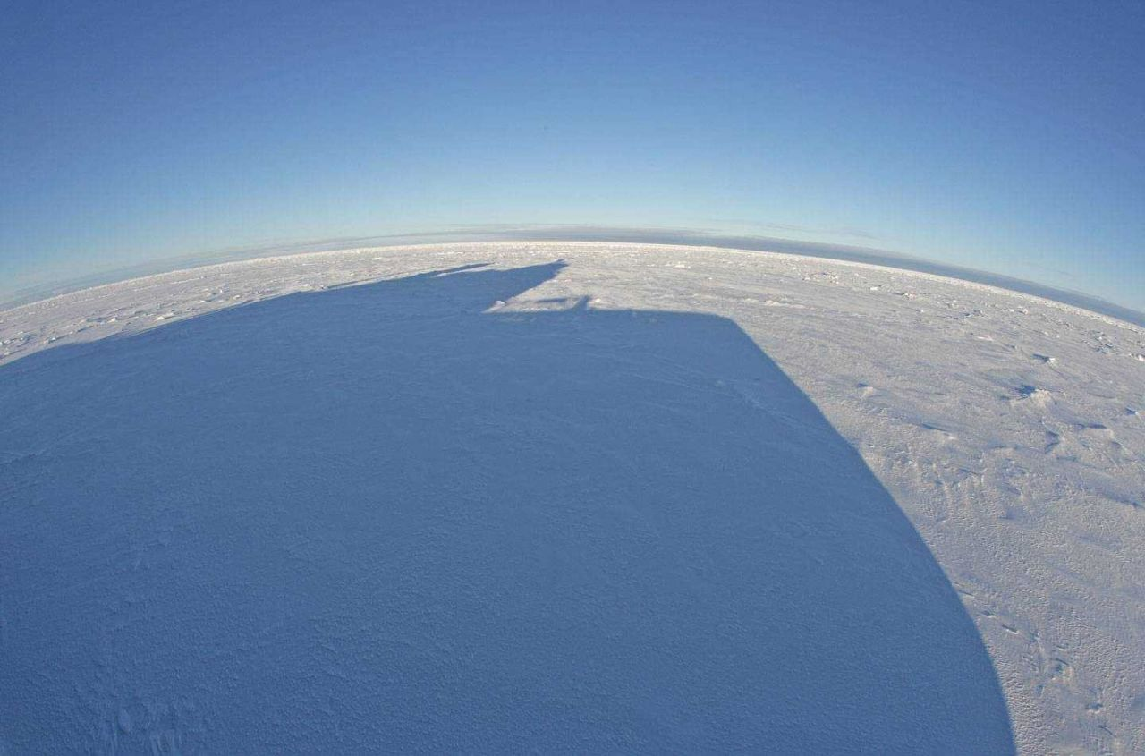 Shadow of the pilot house of the KAPITAN DRANITSYN on the ice Photo