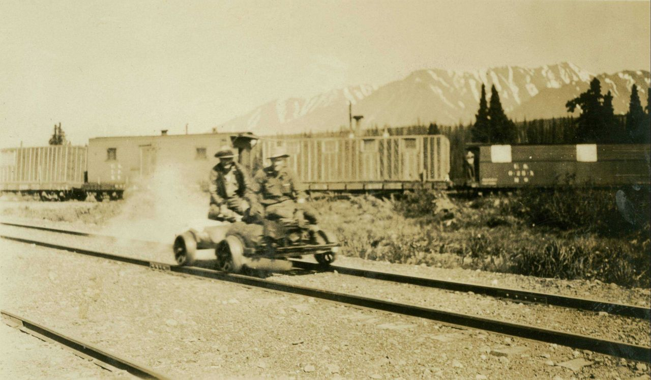 A gasoline powered velocipede underway near a railroad siding on the Anchorage to Fairbanks railway. Photo
