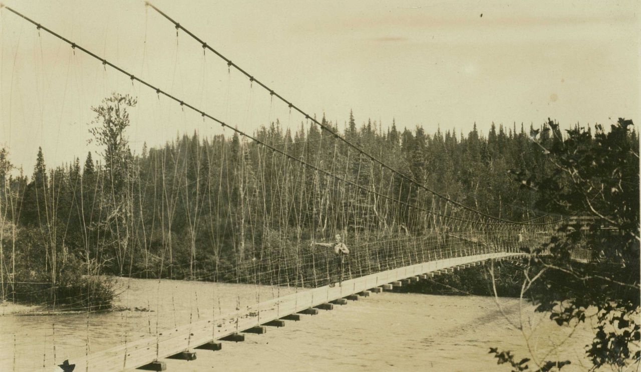 Crossing over one of the many rivers in central Alaska on a suspension bridge Photo