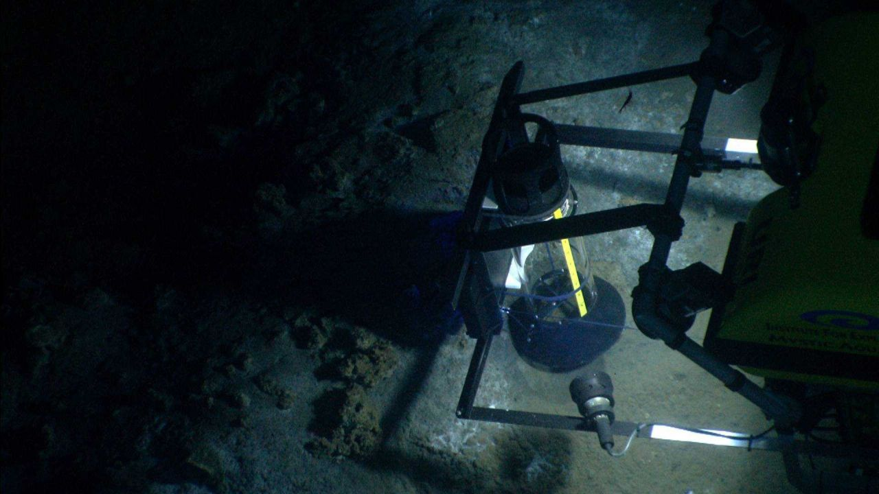 The Little Hercules remotely operated vehicle, outfitted with a 'methane bucket' capture device, captures gas bubbles percolating up from a seafloor g Photo