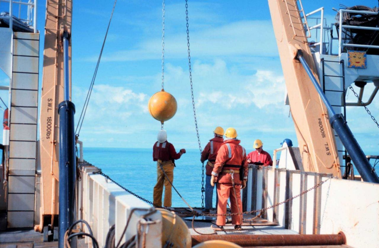 Deploying an oceanographic buoy from the NOAA Ship MILLER FREEMAN Photo