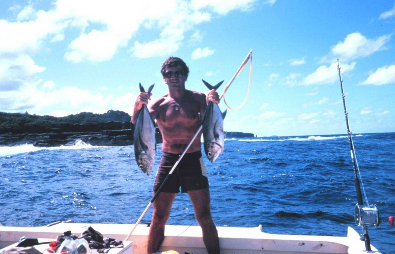 Diver with two jacks (Ulua) Photo