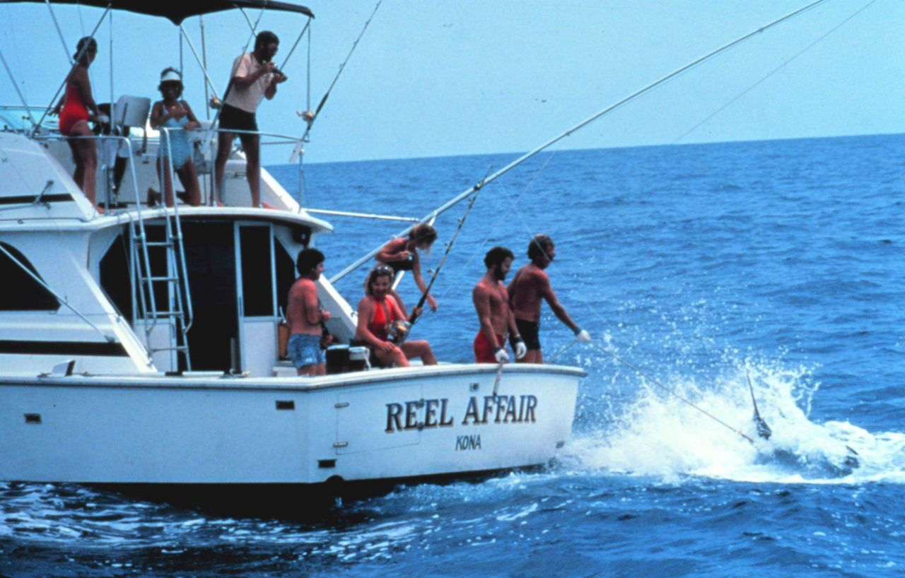 Charter vessel (CPFV) REEL AFFAIR showing large marlin being brought to the side of the boat Photo