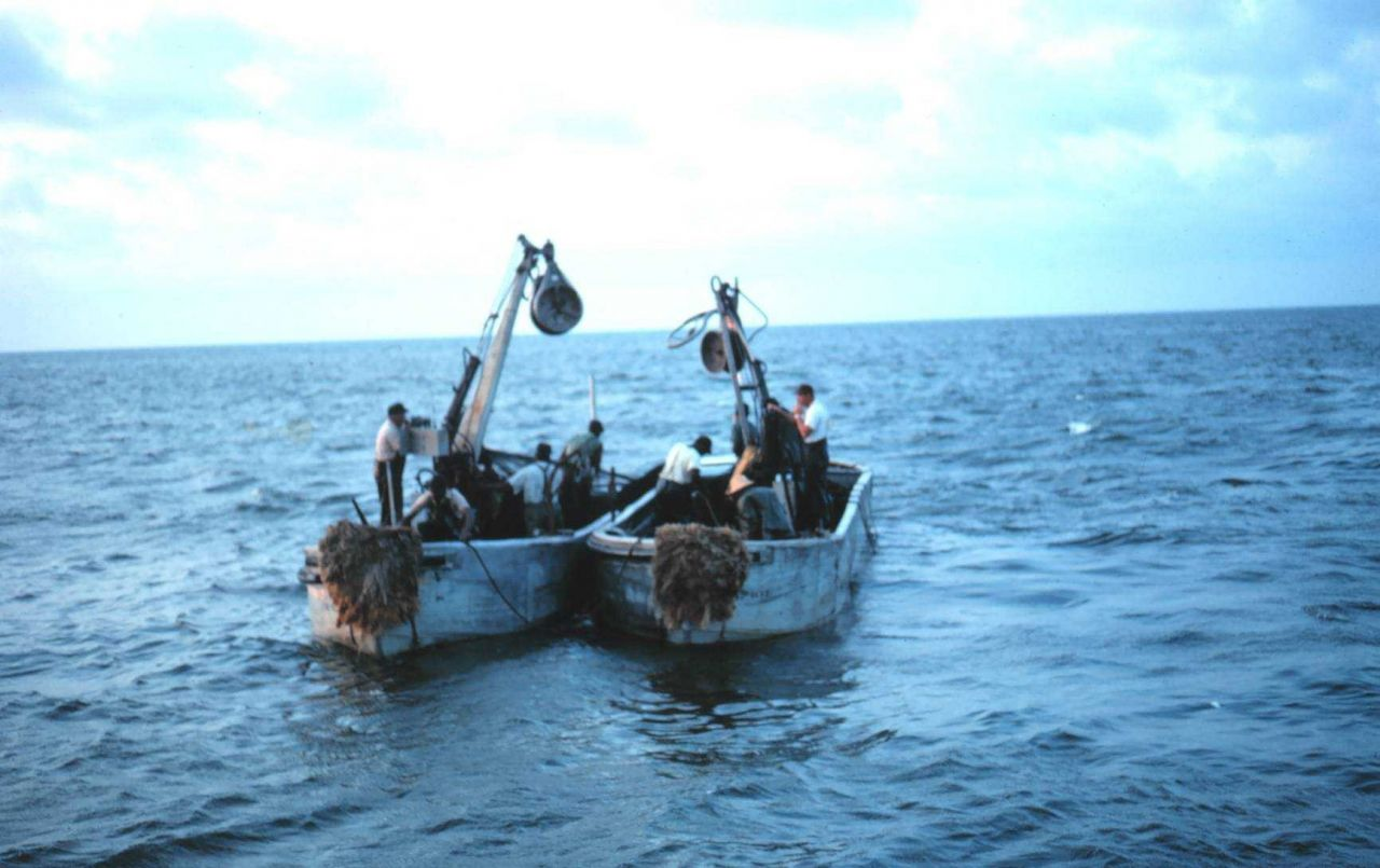 Menhaden fishing - Preparing to deploy net during two-boat purse seining operation Photo