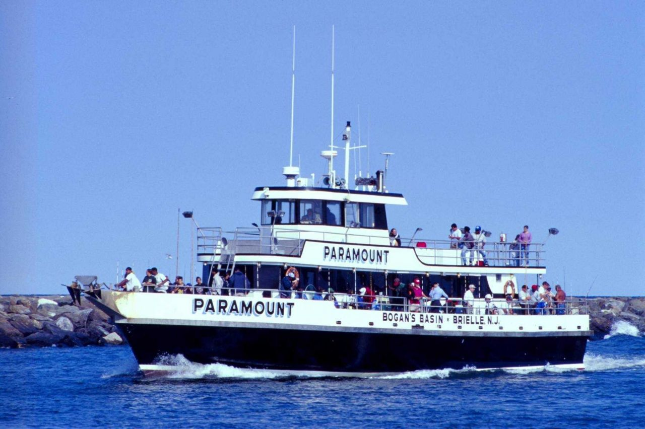 A head boat filled with satisfied customers returns to its home port of Pt Photo