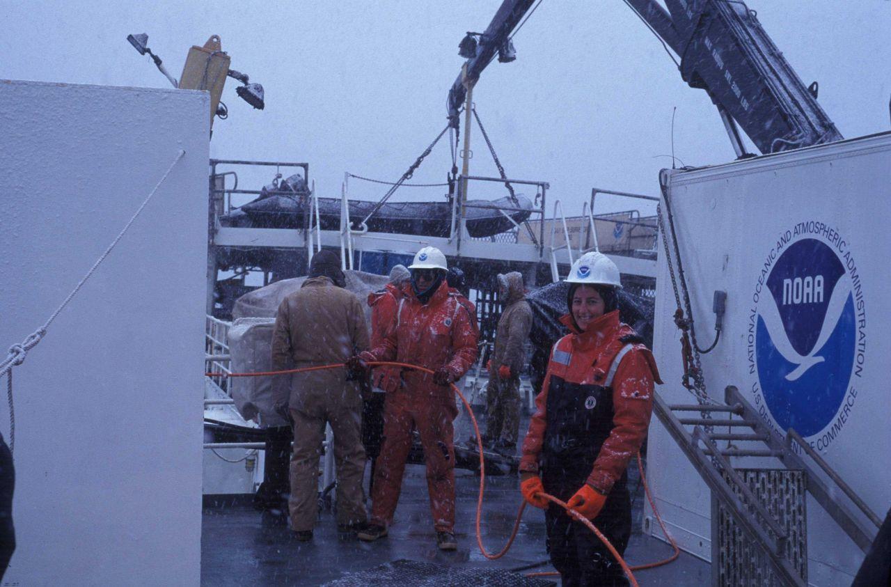 Jane Rosenberg handling ROV umbilical cord on NOAA Ship Surveyor. Photo