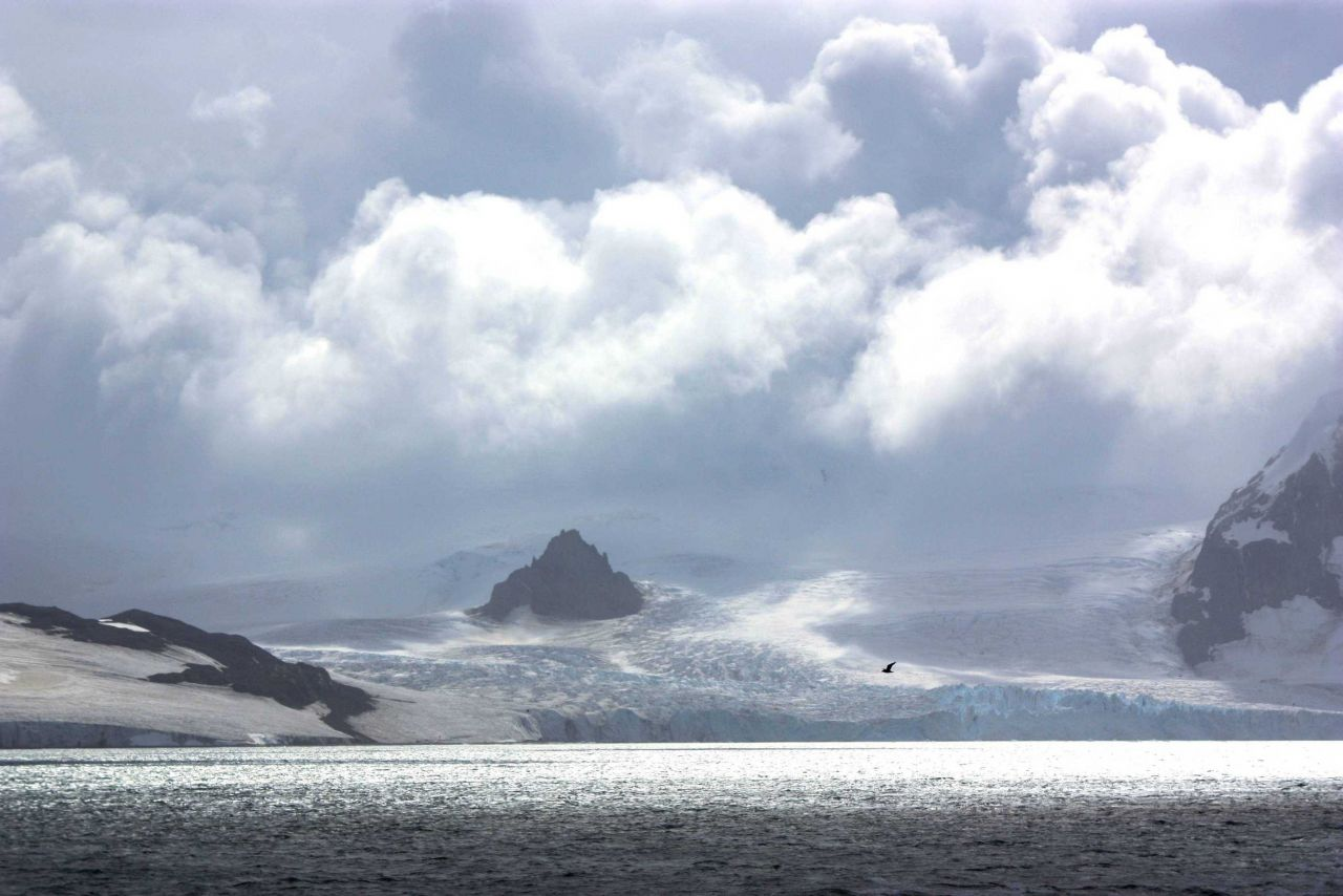 A mountain almost buried by a glacier. Photo
