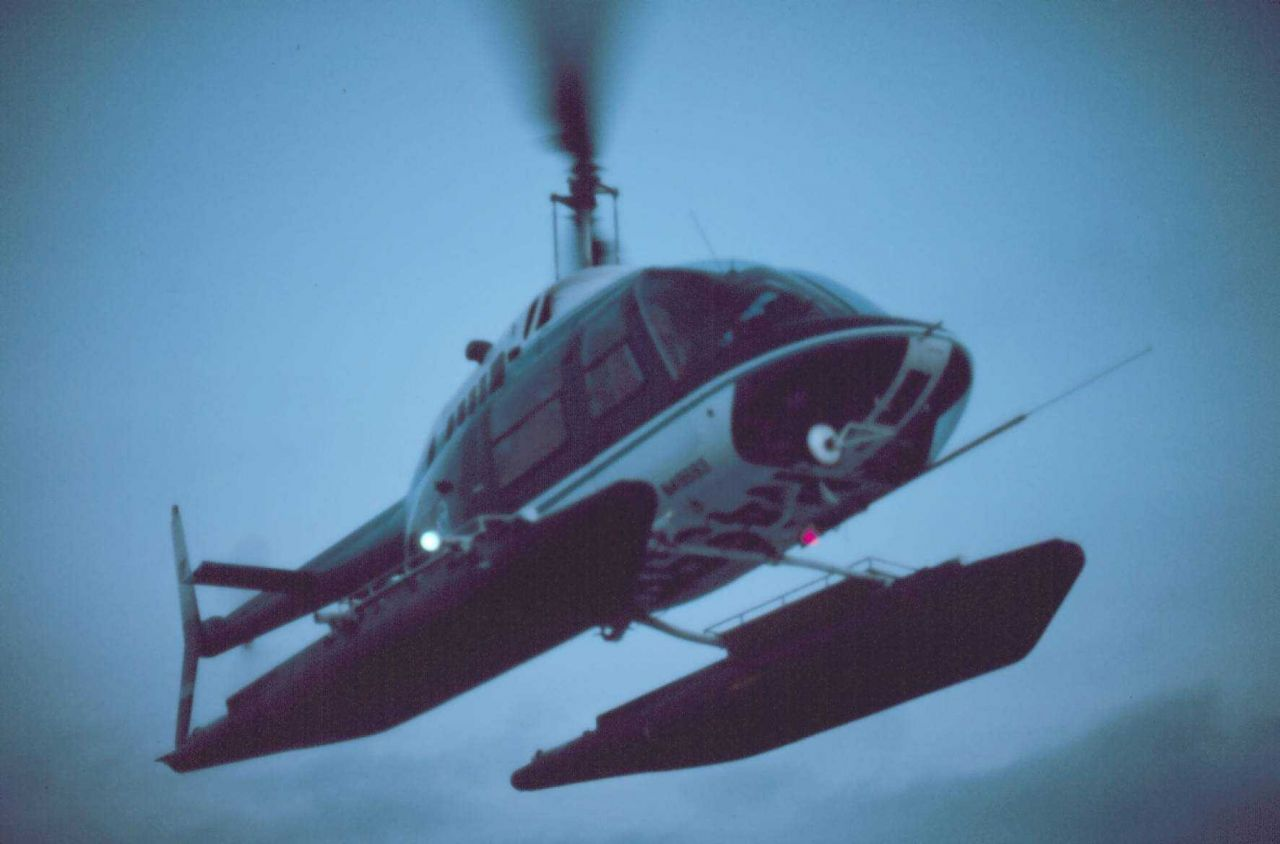 Lieutenant Budd Christman flying leased Bell 206 in Bering Sea coming in for landing on SURVEYOR. Photo