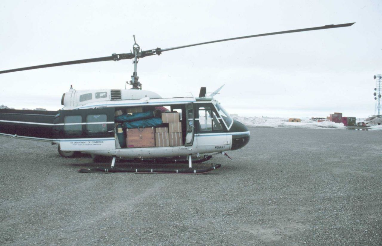 Loaded Bell UH-1M helicopter with camp gear for bird studies in the Prudhoe Bay area. Photo