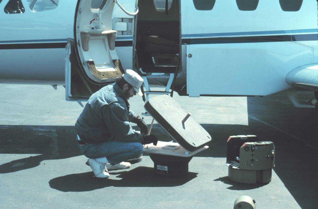 Photogrammetrist Bill Hawken preparing NOAA Cessna Citation II for mission. Photo