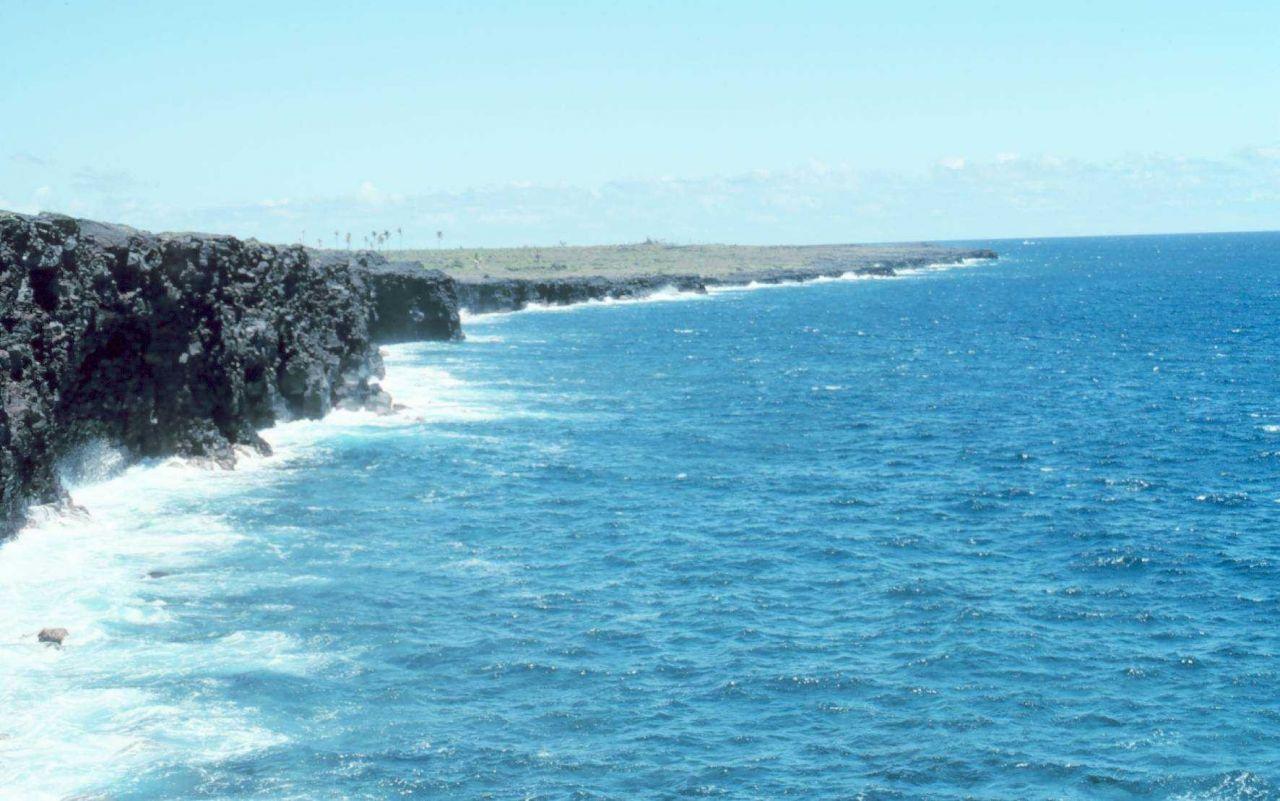 Black lava cliffs in the Kamoamoa area along southeast coast near Kilauea Photo