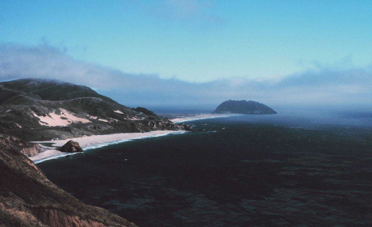 Coastal fog creeping in to Point Sur, about 25 miles south of Carmel Photo