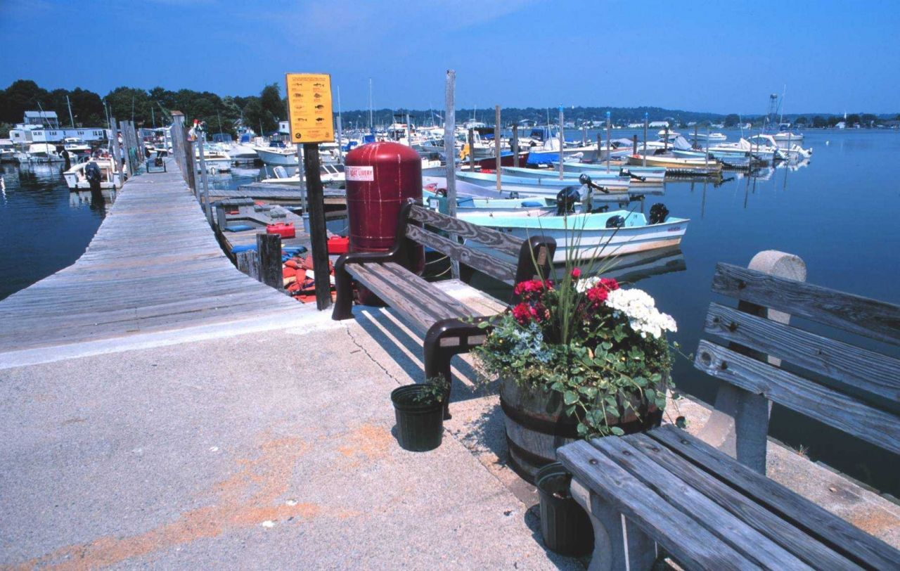 Small recreational fishing boats for rent at Mystic Harbor Photo