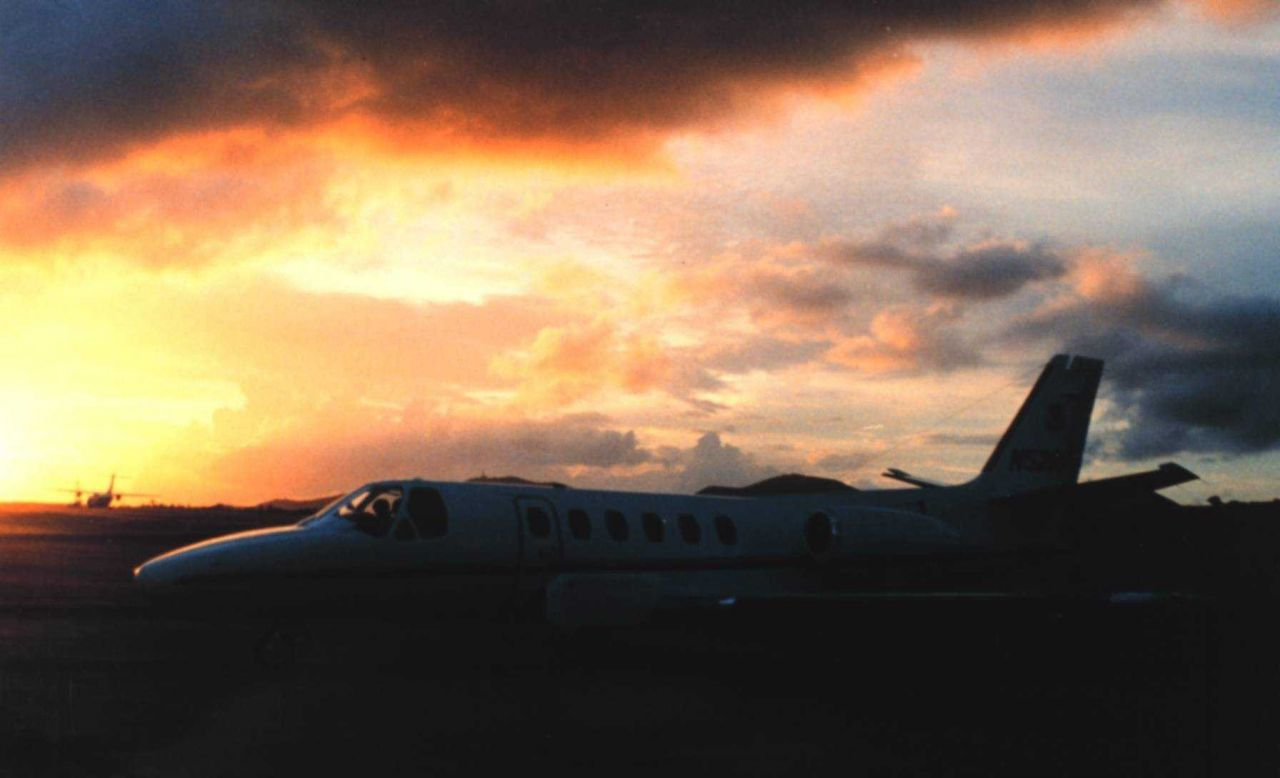 NOAA Cessna Citation II jet aircraft at sunset at Rohlsen International Airport. Photo