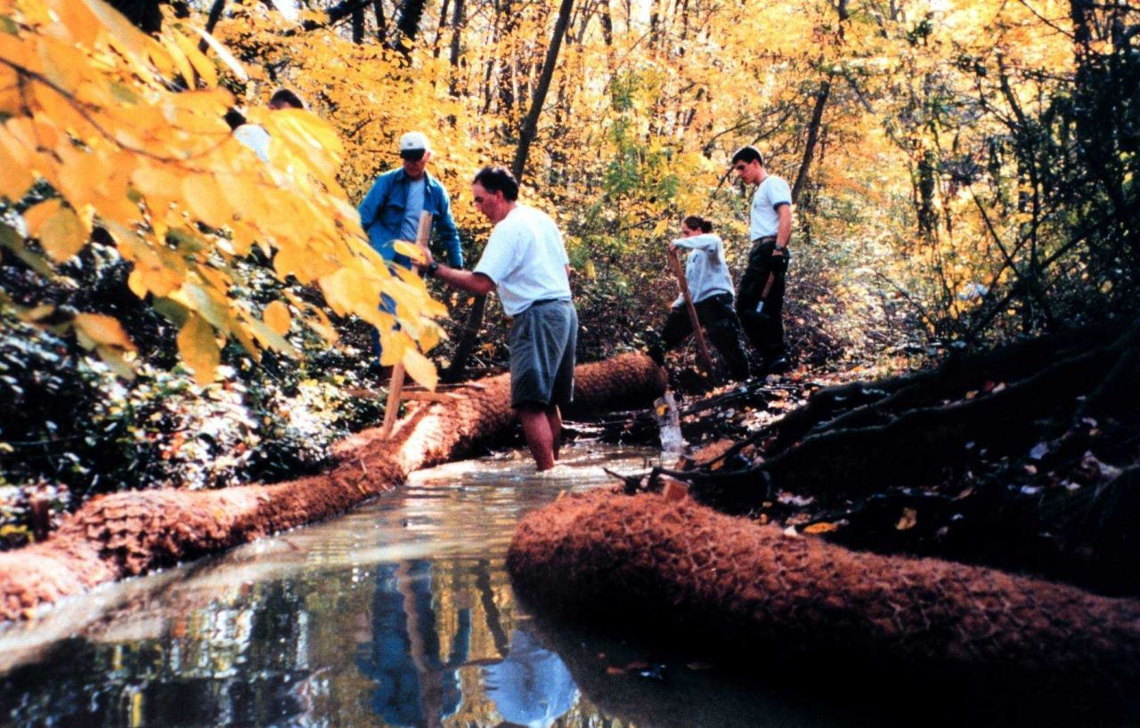 Installing Biologs to abate erosion problems along Spa Creek. Photo
