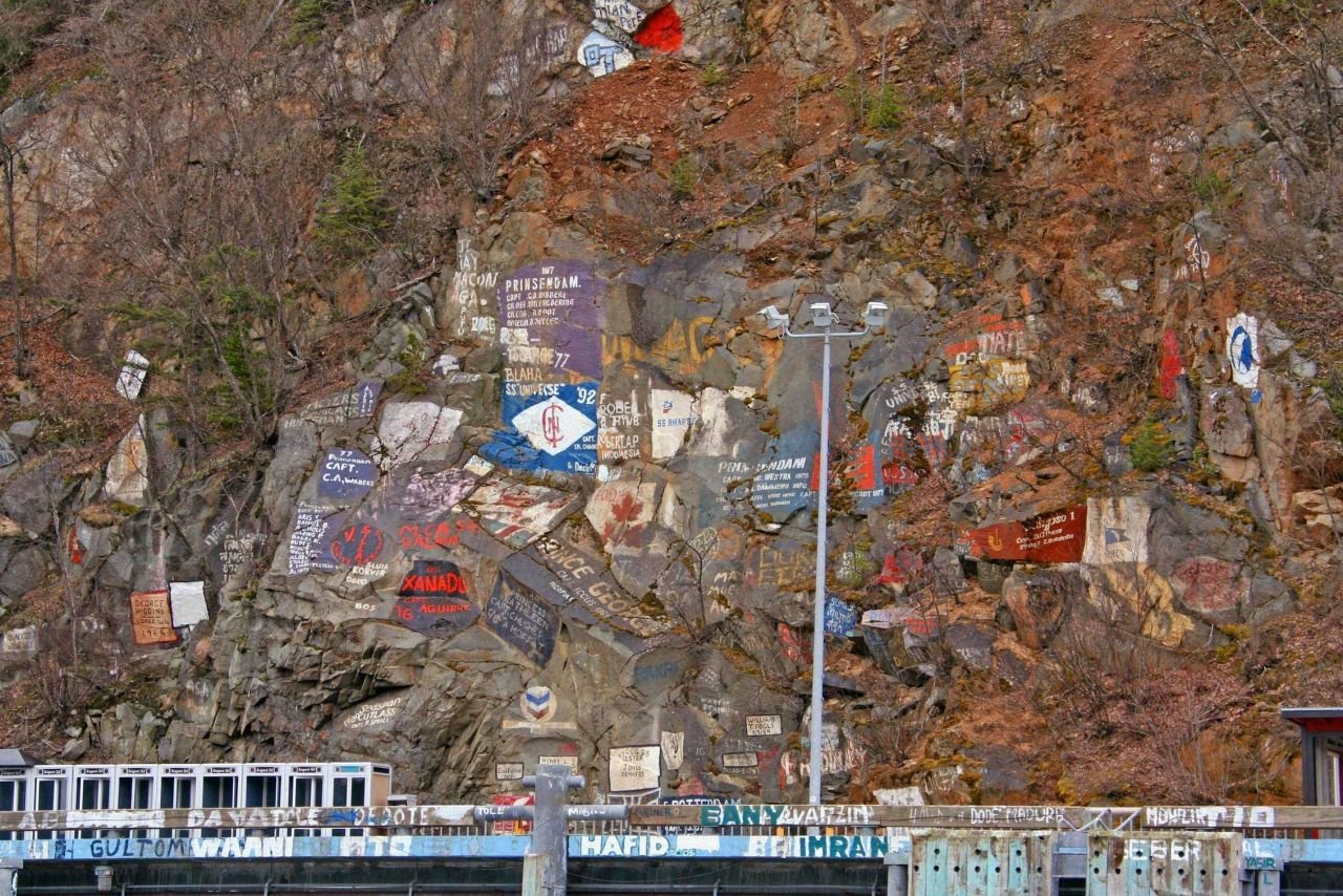 The dock at Skagway with artwork commemorating the ships that have visited here Photo