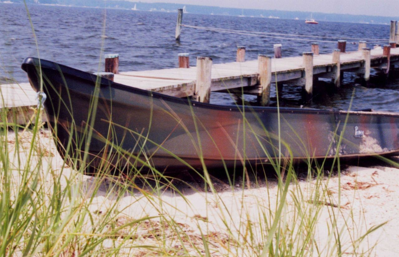 A camouflage-painted hunting skiff along the Patuxent River. Photo