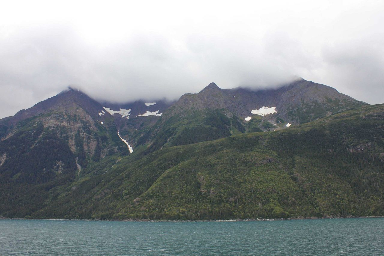 A scene on Lynn Canal with cloud-shrouded mountain peaks. Photo