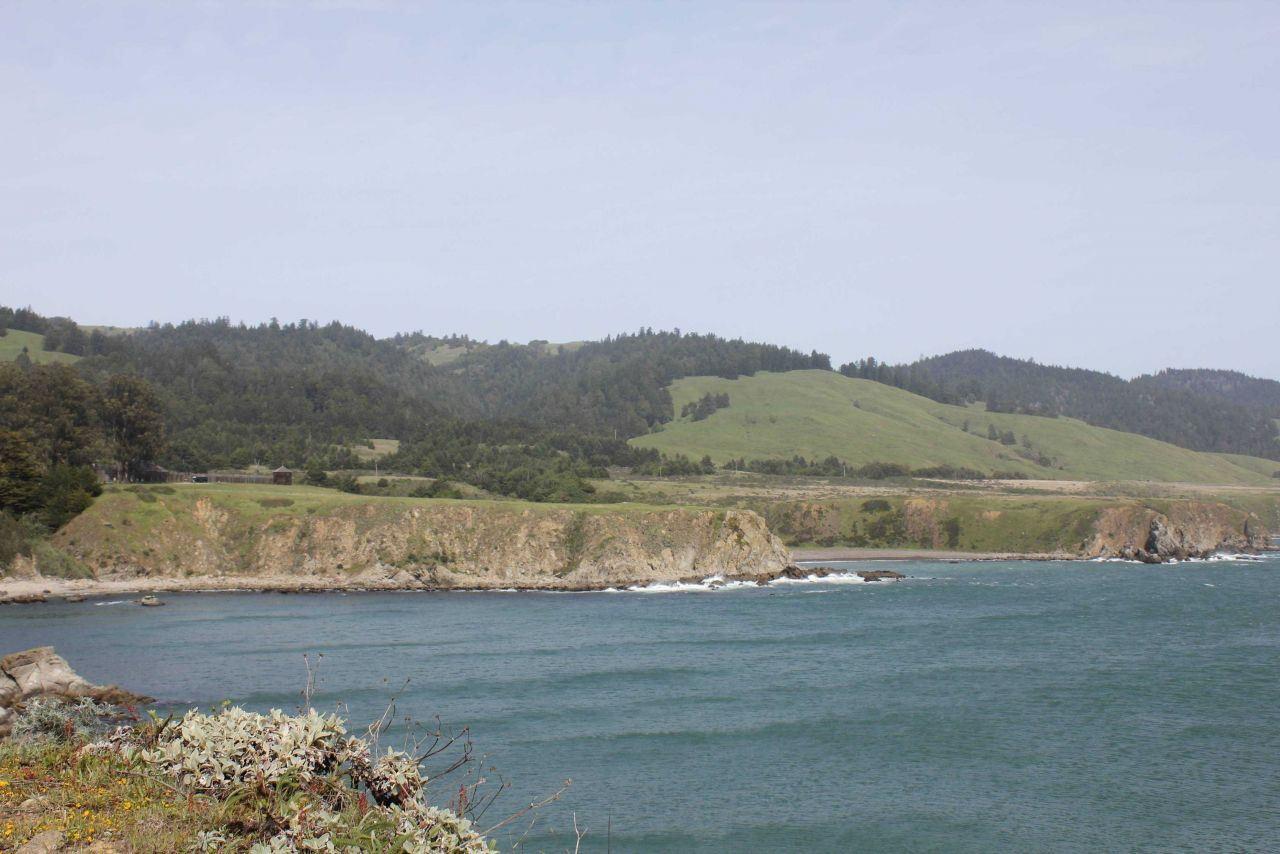 A view of the sea cliffs and coast ranges near Fort Ross, seen in the middle left. Photo