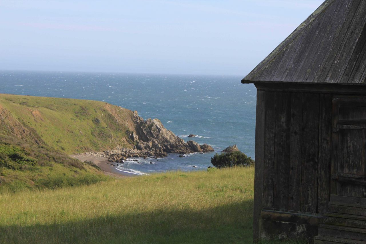 A view of the cove and rocky outcrop at Fort Ross. Photo