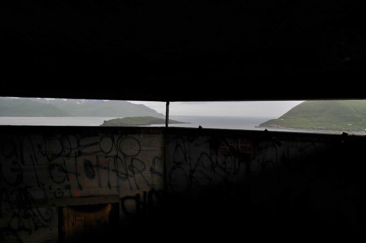 Looking out the view ports of the World War II lookout bunker at Dutch Harbor. Photo