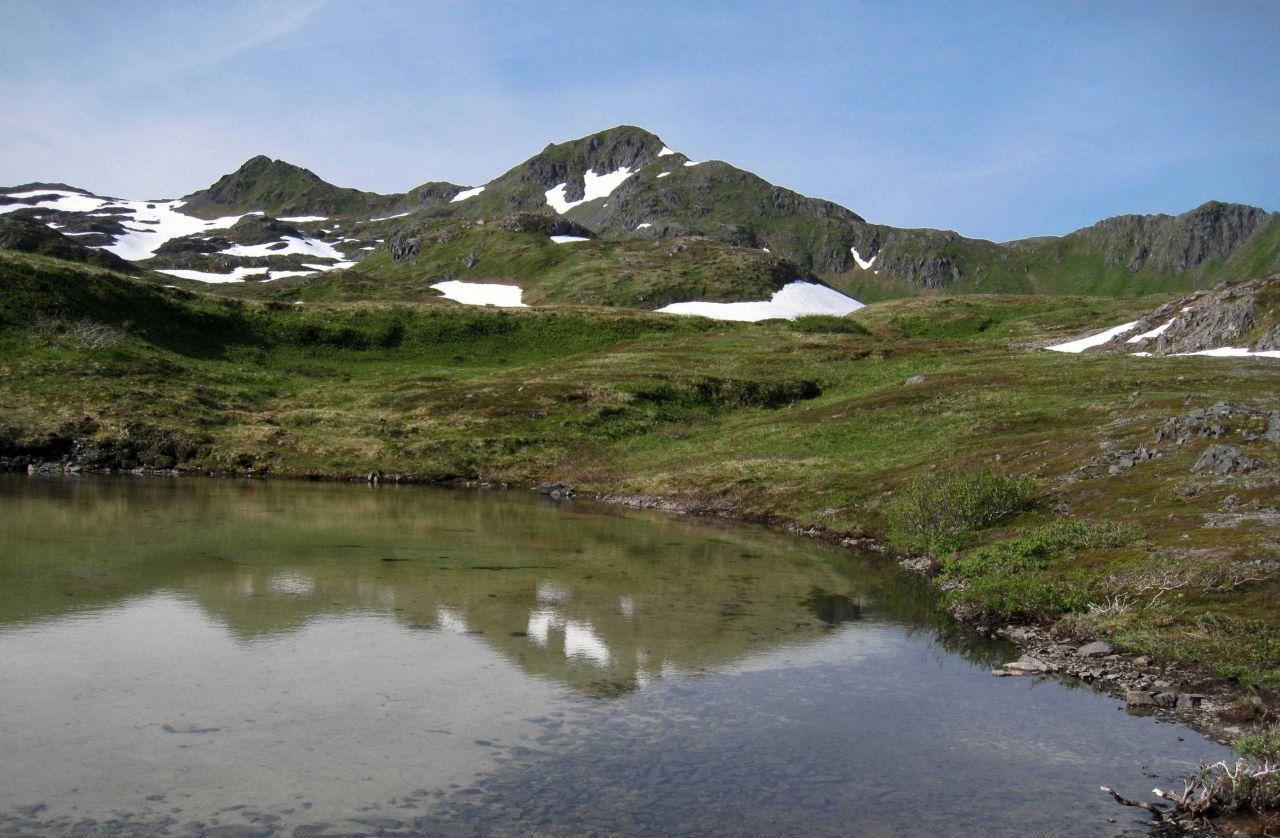 An alpine lake in the mountains of Kodiak. Photo