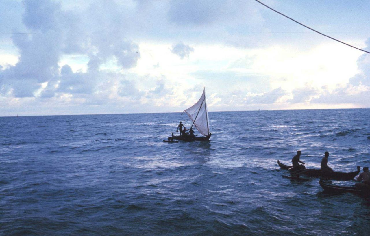 Native Micronesian fishermen greeting the TOWNSEND CROMWELL Few Micronesians use traditional sailing outrigger canoes today. Photo