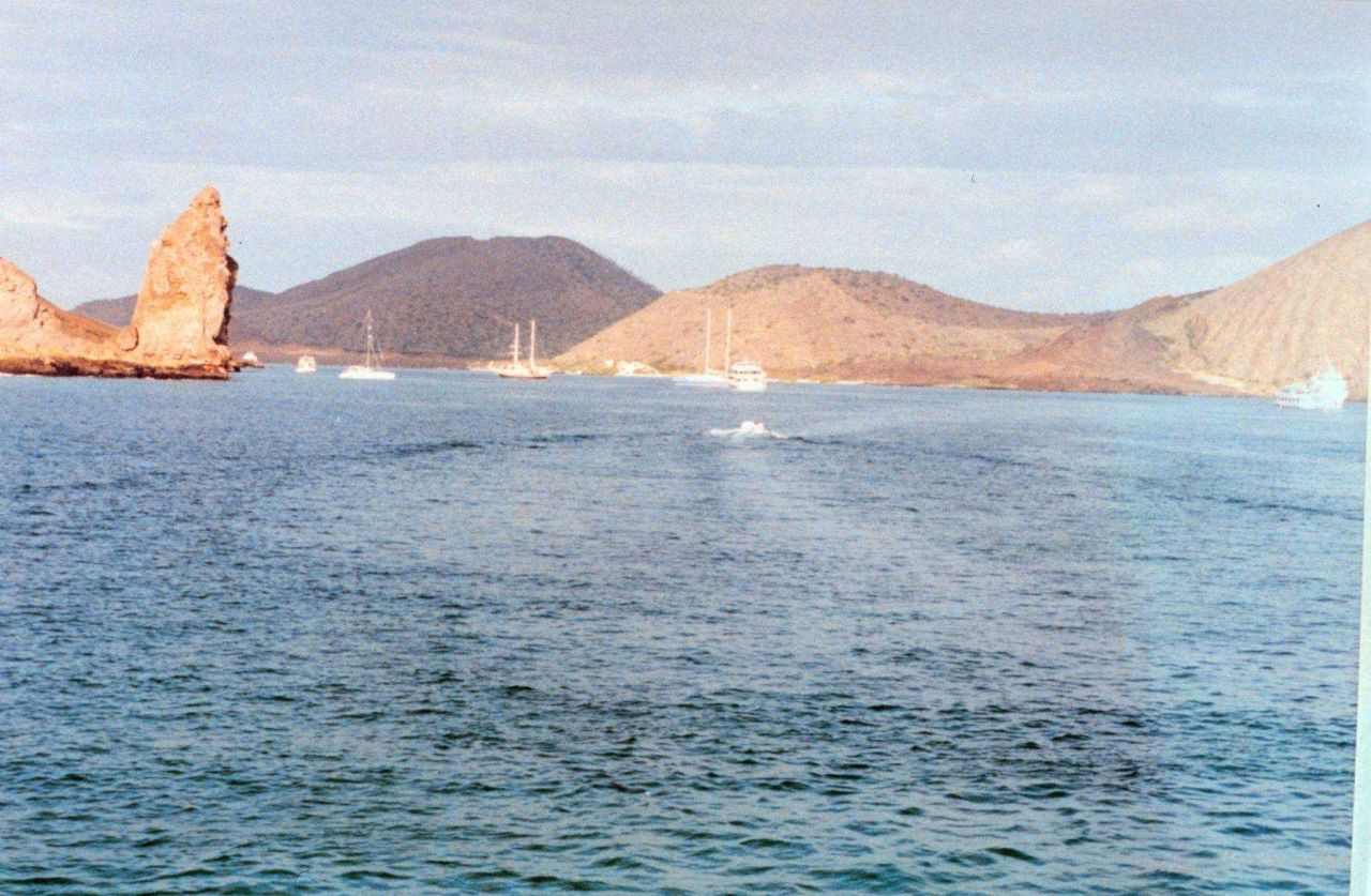 Boats anchored offshore from Pinnacle Rock Photo