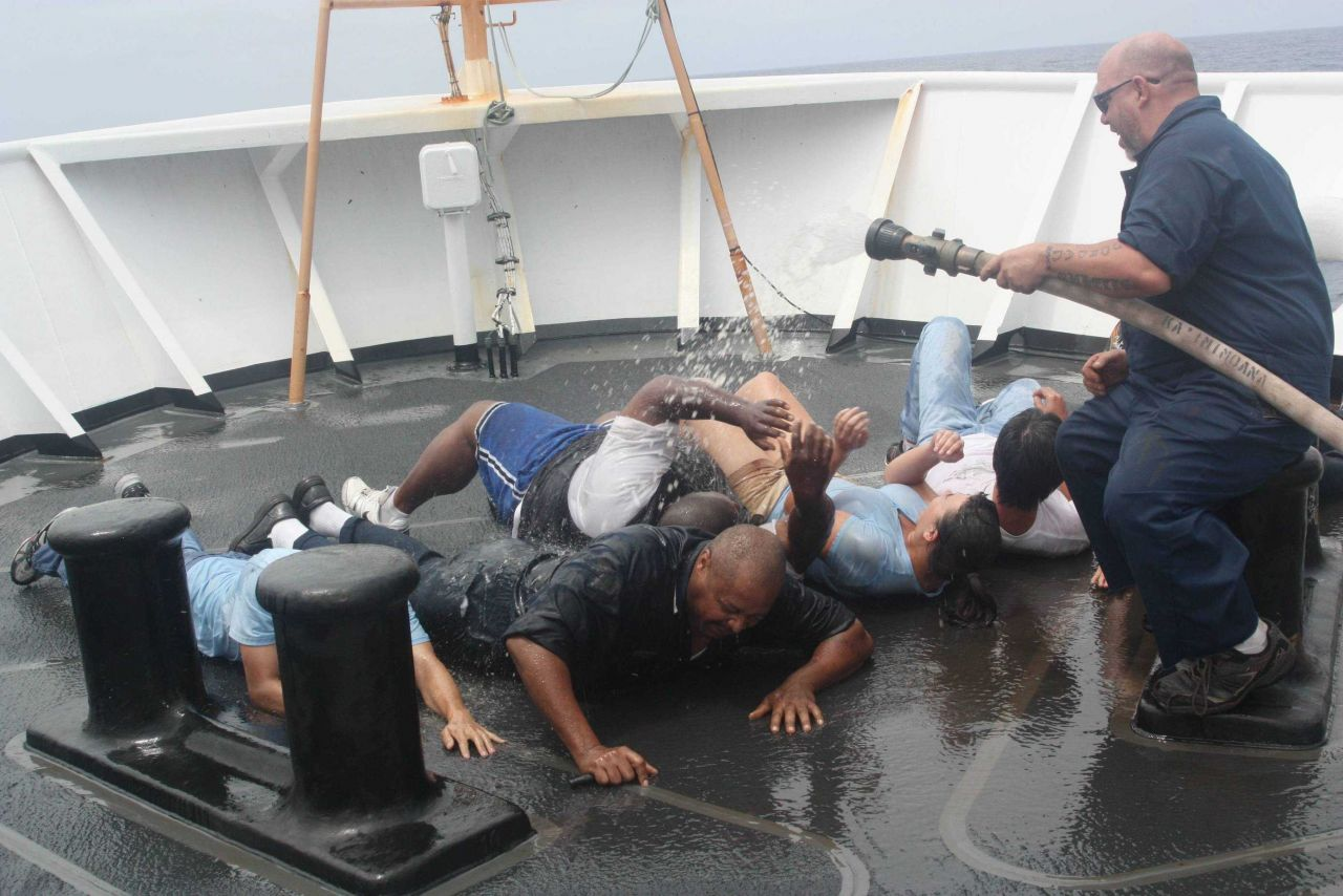 Shellback helping cleanup pollywogs during equator crossing ceremonies on the NOAA Ship KA'IMIMOANA (R333) Photo