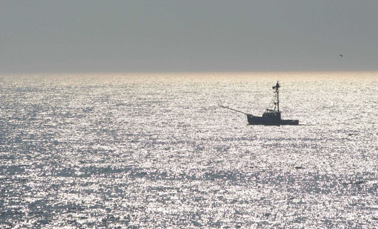 Swordfish boat with lookout in the afternoon sun Photo