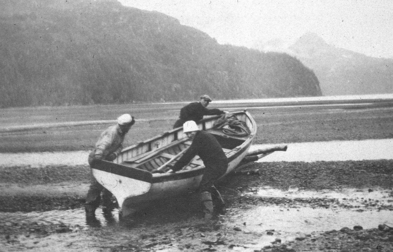 Taking boat for a walk over the mudflats Photo