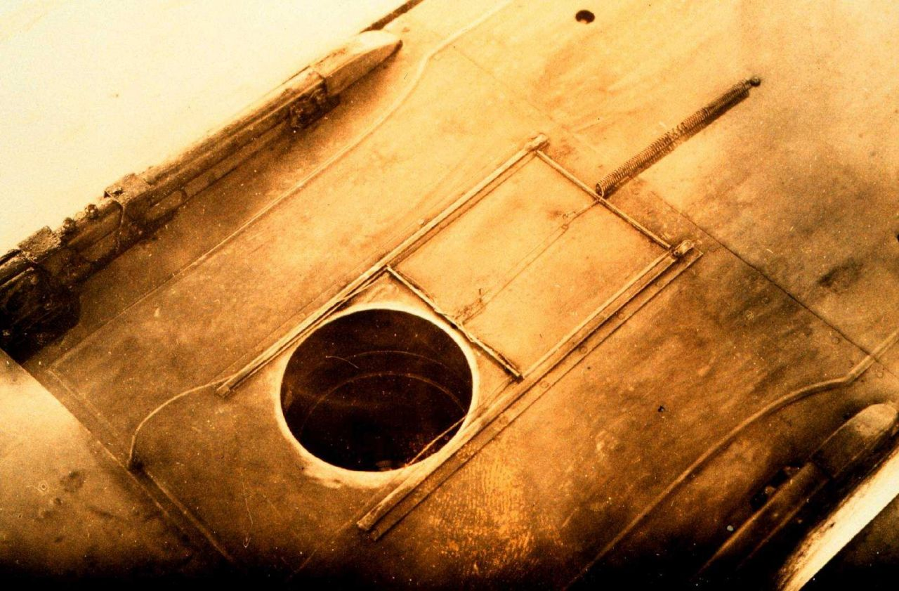 Opening in bottom of plane for K-1 camera Photo