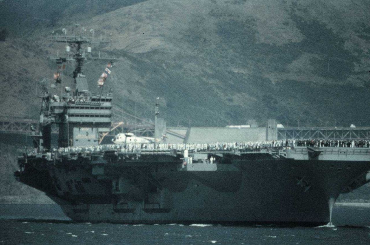 An aircraft carrier in San Francisco Bay fills the field of view Photo