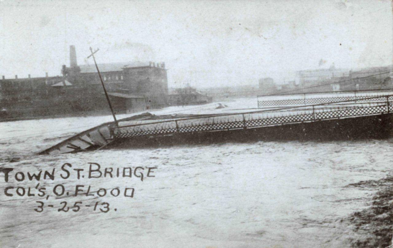 Town Street Bridge broken from flood waters. Photo