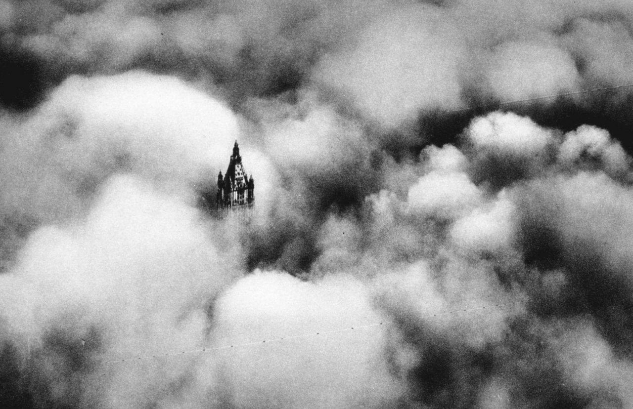 The top of the Woolworth Building seen through the fog Photo