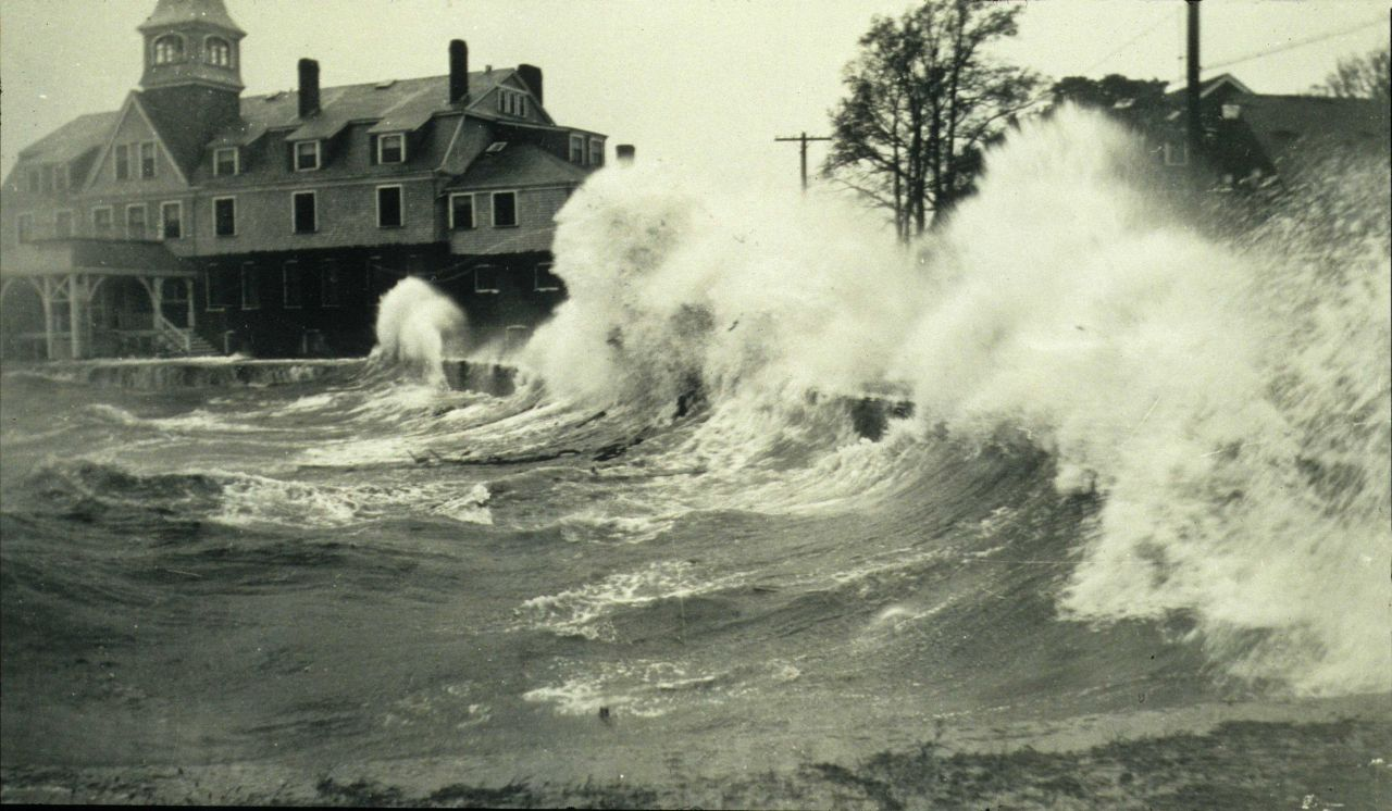 Waves batter the seawall at Woods Hole during the 1938 hurricane. Photo