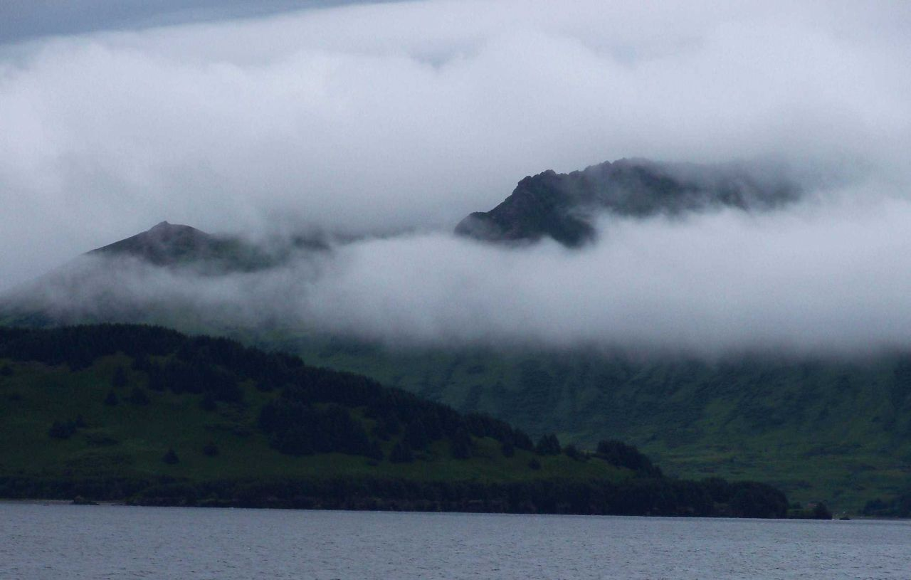 Clouds at different levels on Kodiak Island. Photo