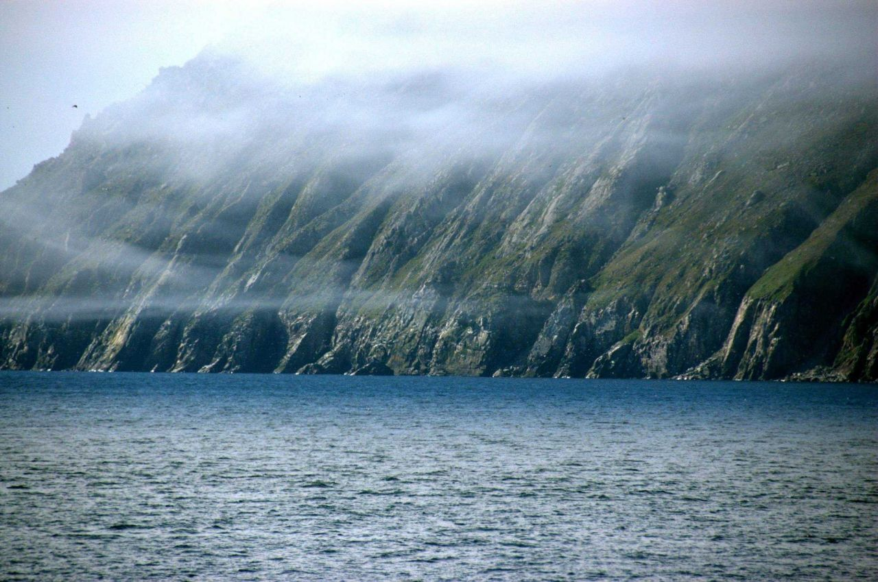Wisps of fog appear like garlands over Little Diomede Island. Photo