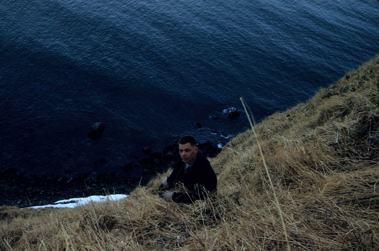 Third Assistant Engineer Tom Garten exploring Ragged Point off the Coast and Geodetic Survey Ship PATHFINDER. Photo