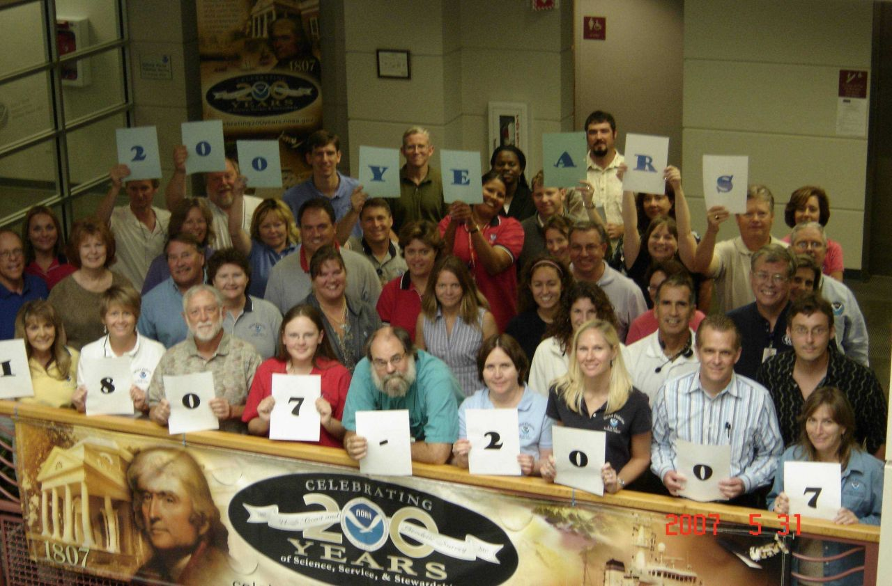 After an All-Hands meeting at NOAA Fisheries' Southeast Regional Office, employees gathered to commemorate NOAA's 200 years of science, service, and s Photo