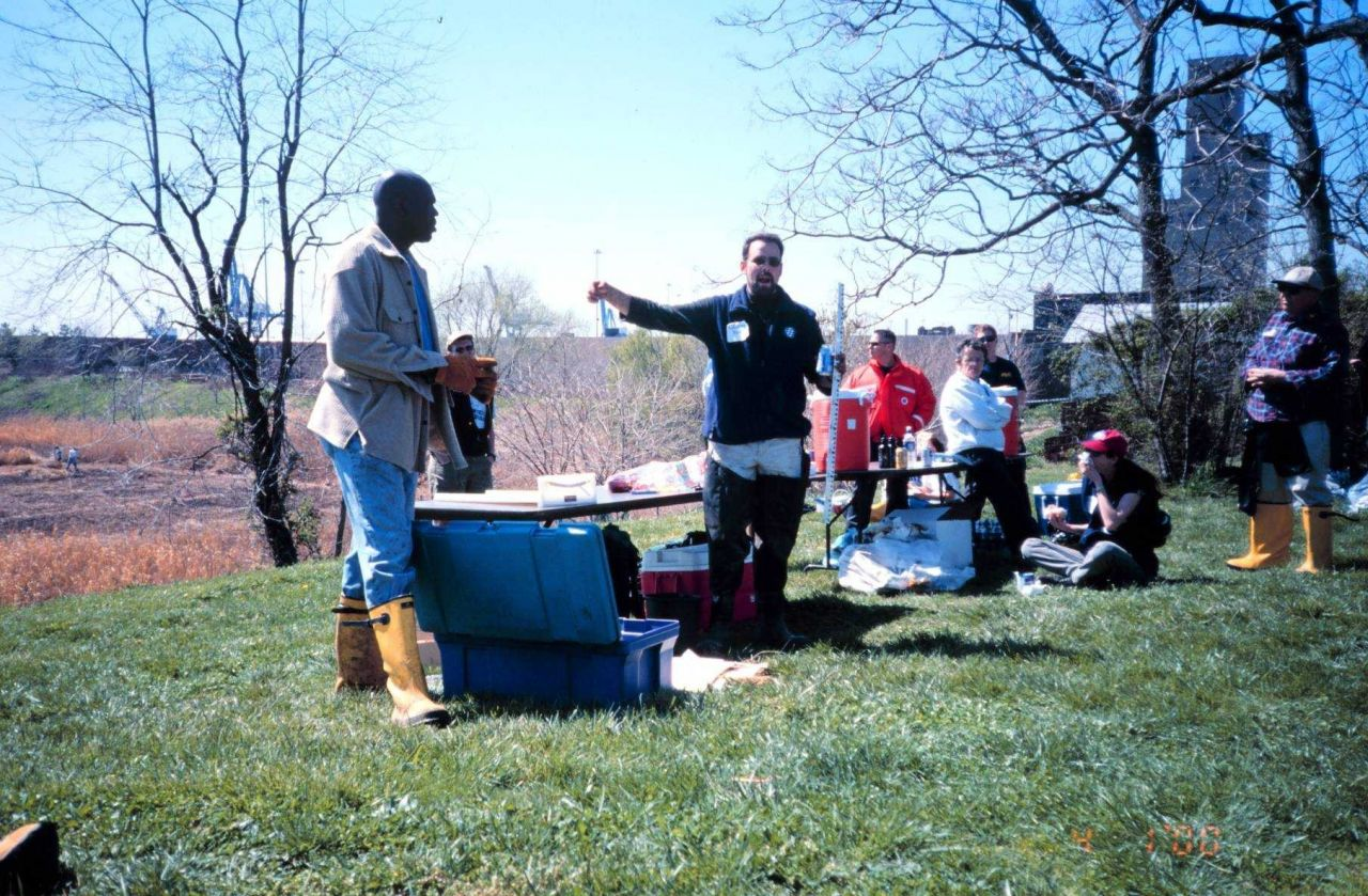 Glenn Page gives a lesson in water quality monitoring. Photo