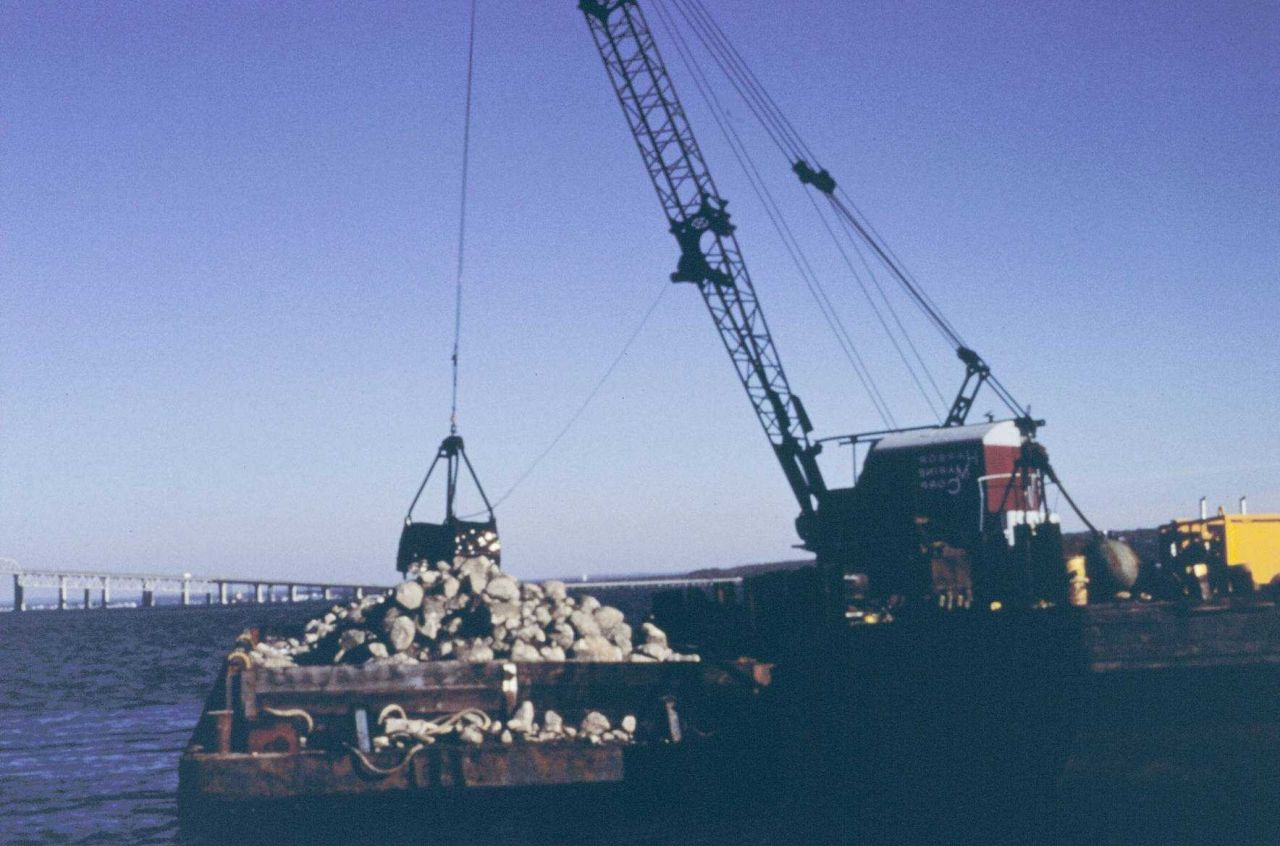 The crane and barge used to construct the cobble reef Photo