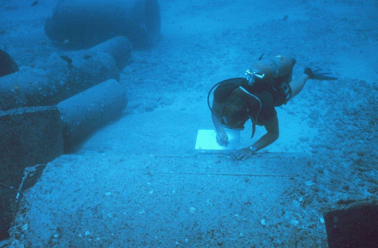 Underwater writing slates were used to record the different species adhering to the top, side and interior roof of pipes over time. Photo