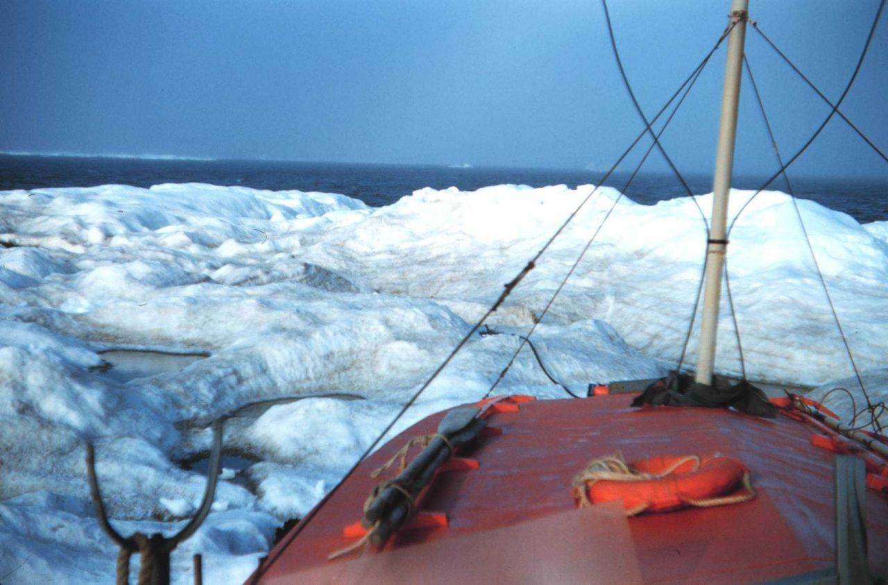 A boat's eyeview of an ice berg Tied up to berg while collecting water Photo