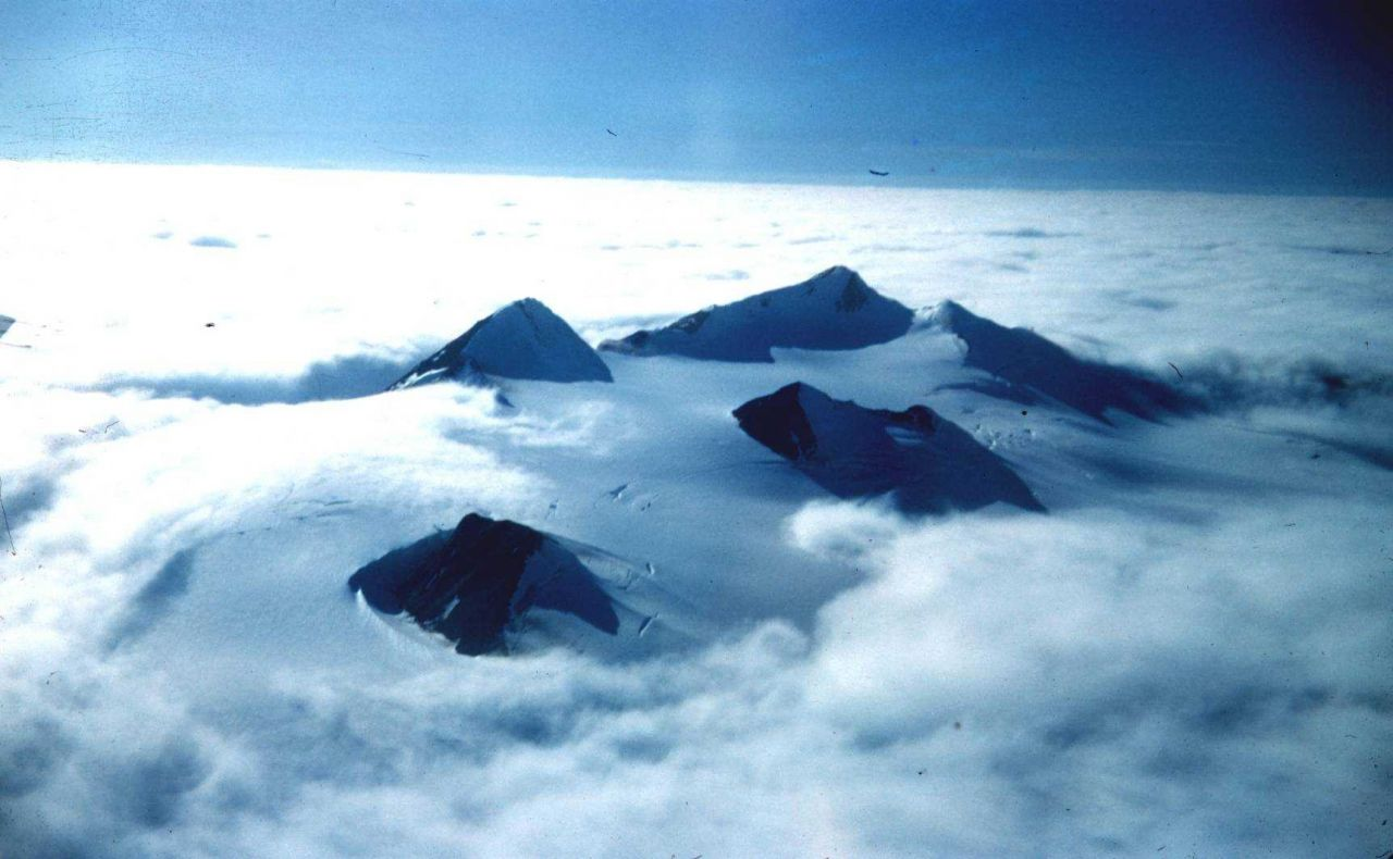 Flying over southeast Alaska mountain peaks on the way home at end of the season Photo