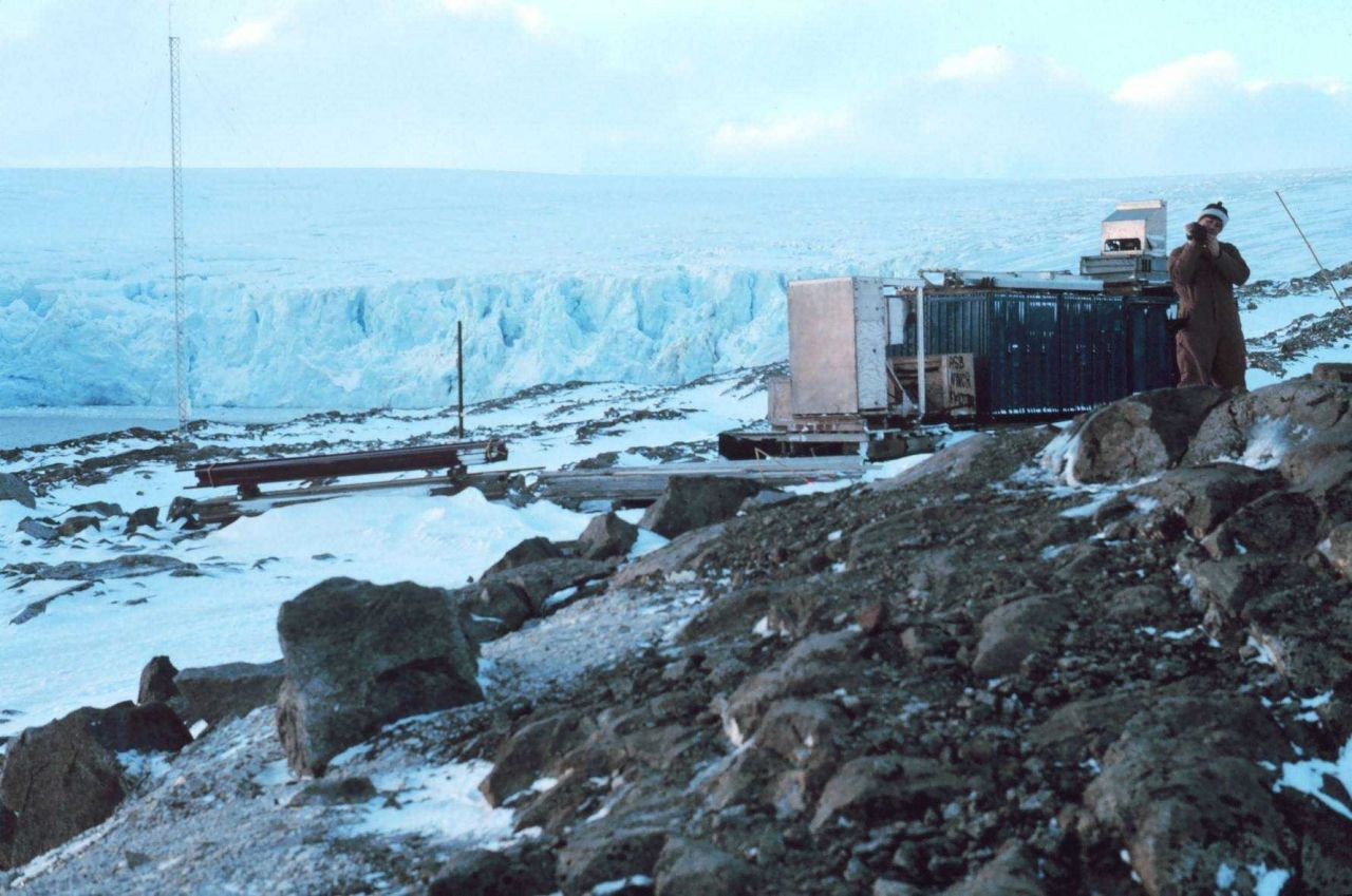 Scientific equipment at Palmer Station with a glacier front in the background Photo