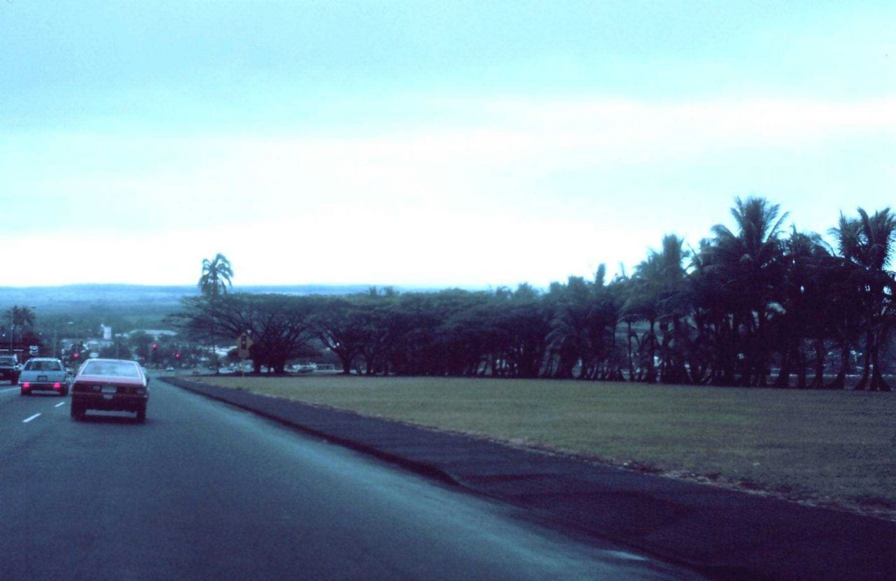A view of Hilo at dusk with a snow-capped Mauna Loa in the background. Photo