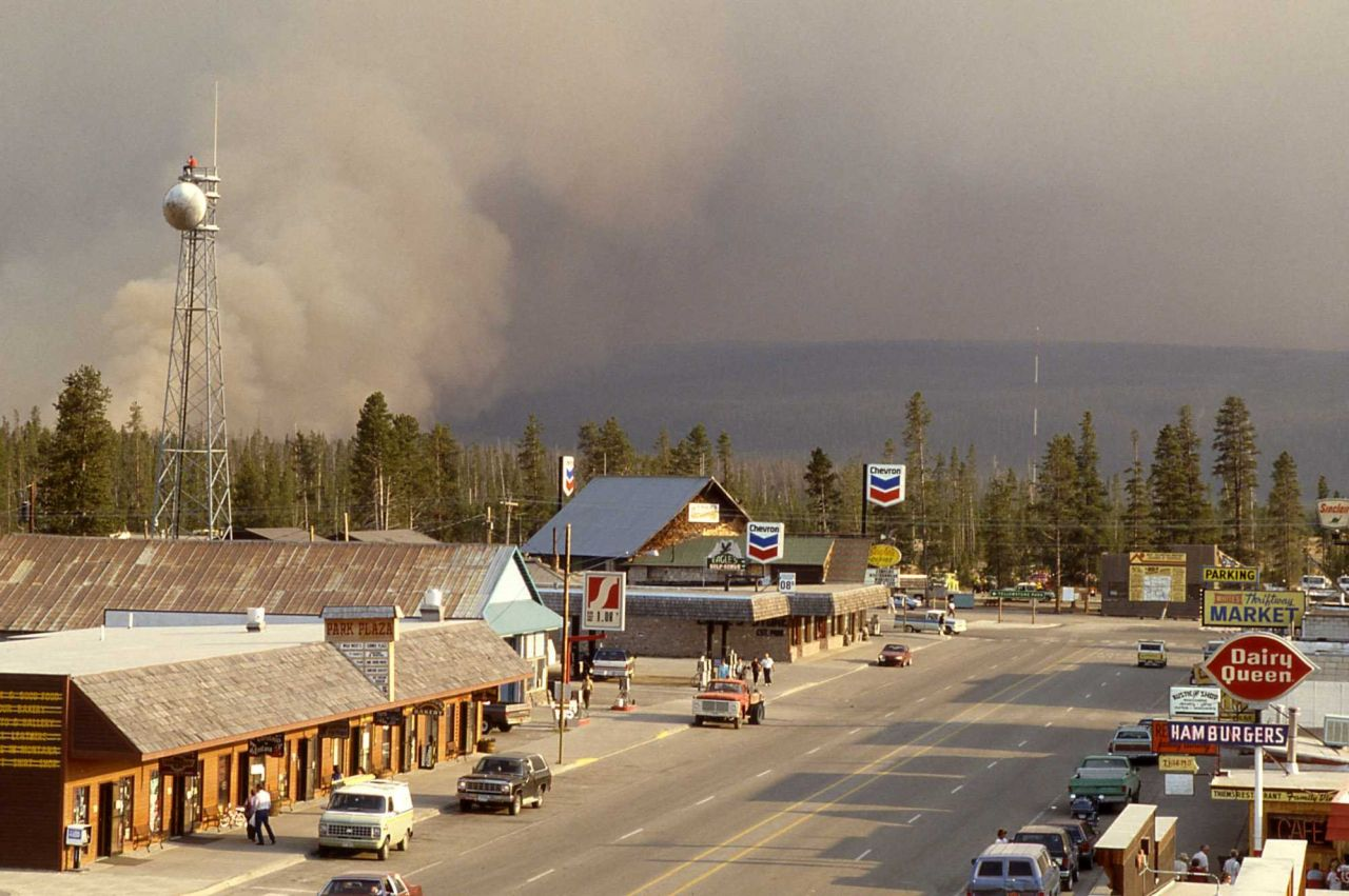 West Yellowstone, Montana business district with smoke plume on edge of town Photo