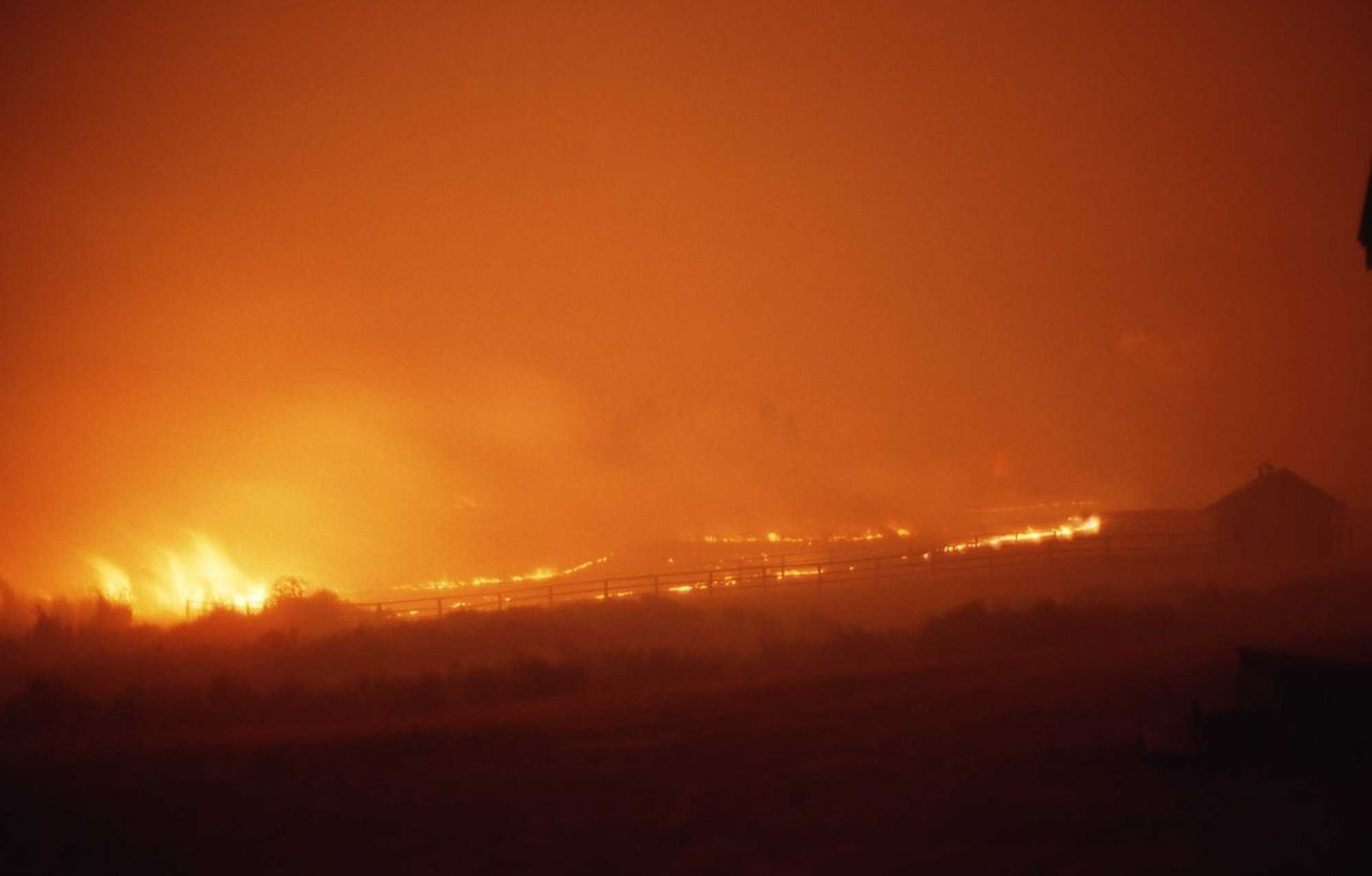Fire approaching upper Blacktail barn at night - Ground fire Photo